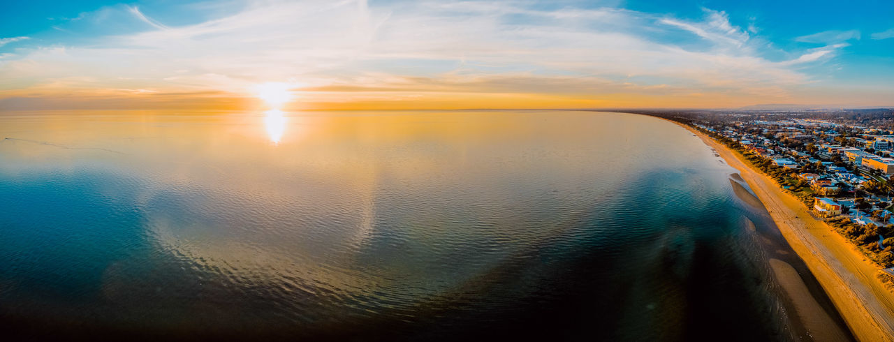 Breathtaking aerial panorama of sun setting over smooth water surface with cloud reflections Aerial Shot Australia Drone  Meditation Panorama Panoramic Aerial Aerial Landscape Aerial Photography Aerial View Beauty In Nature City Cityscape Cloud - Sky Drone Photography Horizon Horizon Over Water Idyllic Lens Flare Melbourne Minimalism Nature No People Outdoors Reflection Scenics - Nature Sea Sky Sun Sunlight Sunset Tranquil Scene Tranquility Water