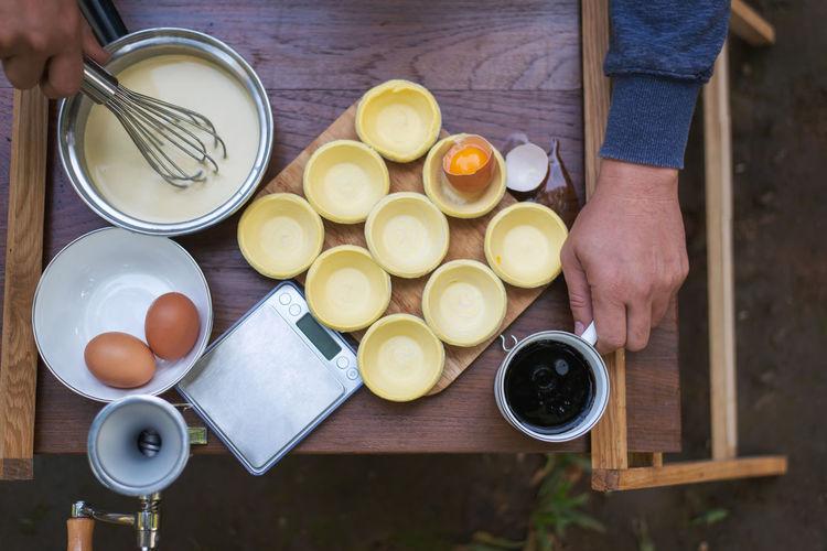 High angle view of man preparing food on table