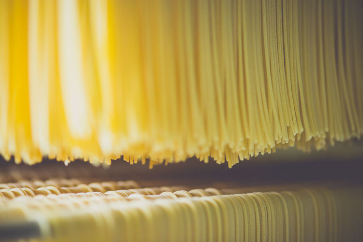 Full frame shot of spaghetti drying in factory