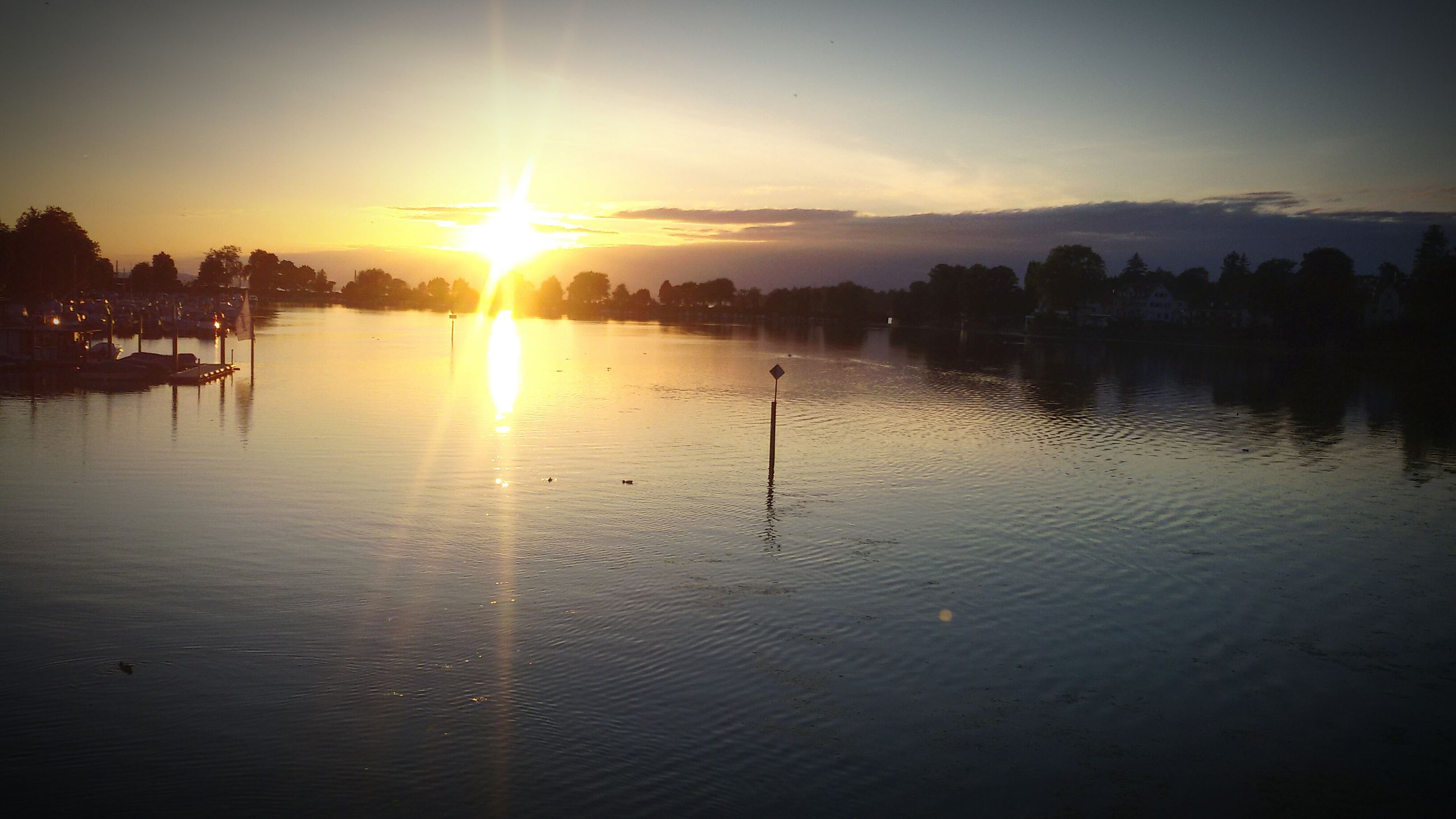 sunset, sun, water, reflection, tranquil scene, scenics, tranquility, lake, sunlight, beauty in nature, silhouette, sky, sunbeam, waterfront, orange color, nature, idyllic, lens flare, rippled, river