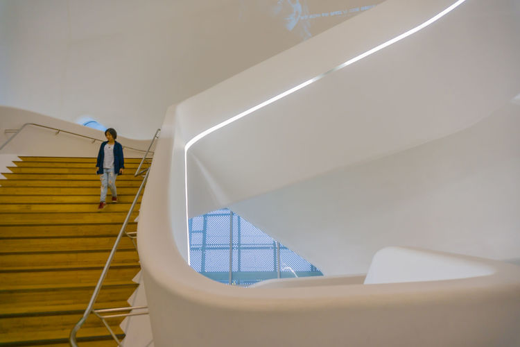 Low angle view of man working on staircase