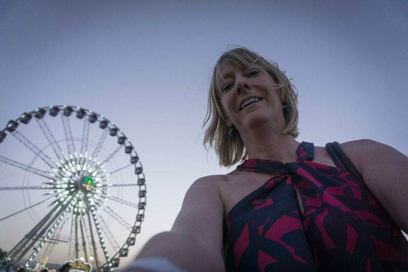 Ferris Wheel Amusement Park Sky Arts Culture And Entertainment Headshot Leisure Activity Real People Women Low Angle View Hairstyle