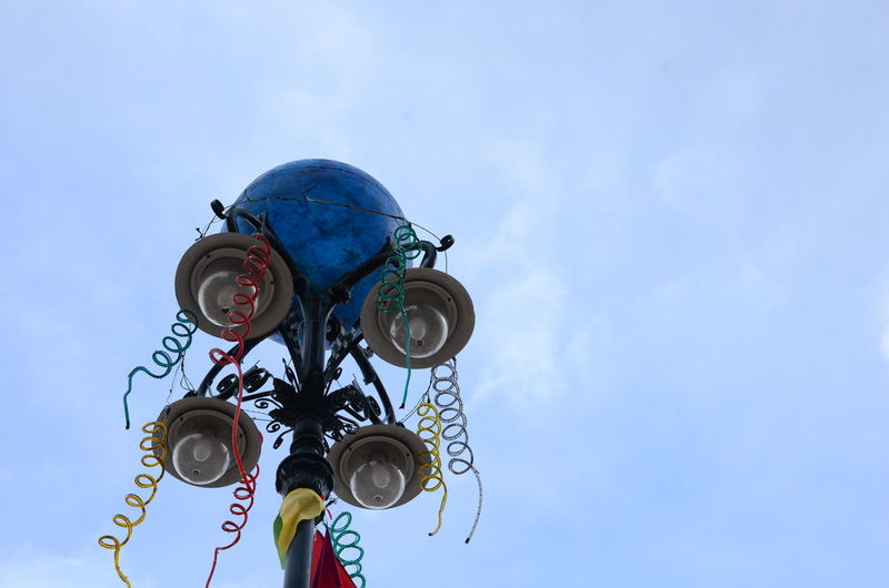 Blue Carnival Cloud Cloud - Sky Culture Day High Section Lighting Equipment Low Angle View No People Outdoors Sky Street Light Tall - High