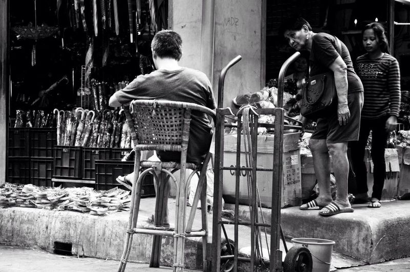 Real People Rear View Sitting Outdoors Lifestyles Bnw Photography Streetphotography Bnw_collection Bnw_captures EyeEm Ready