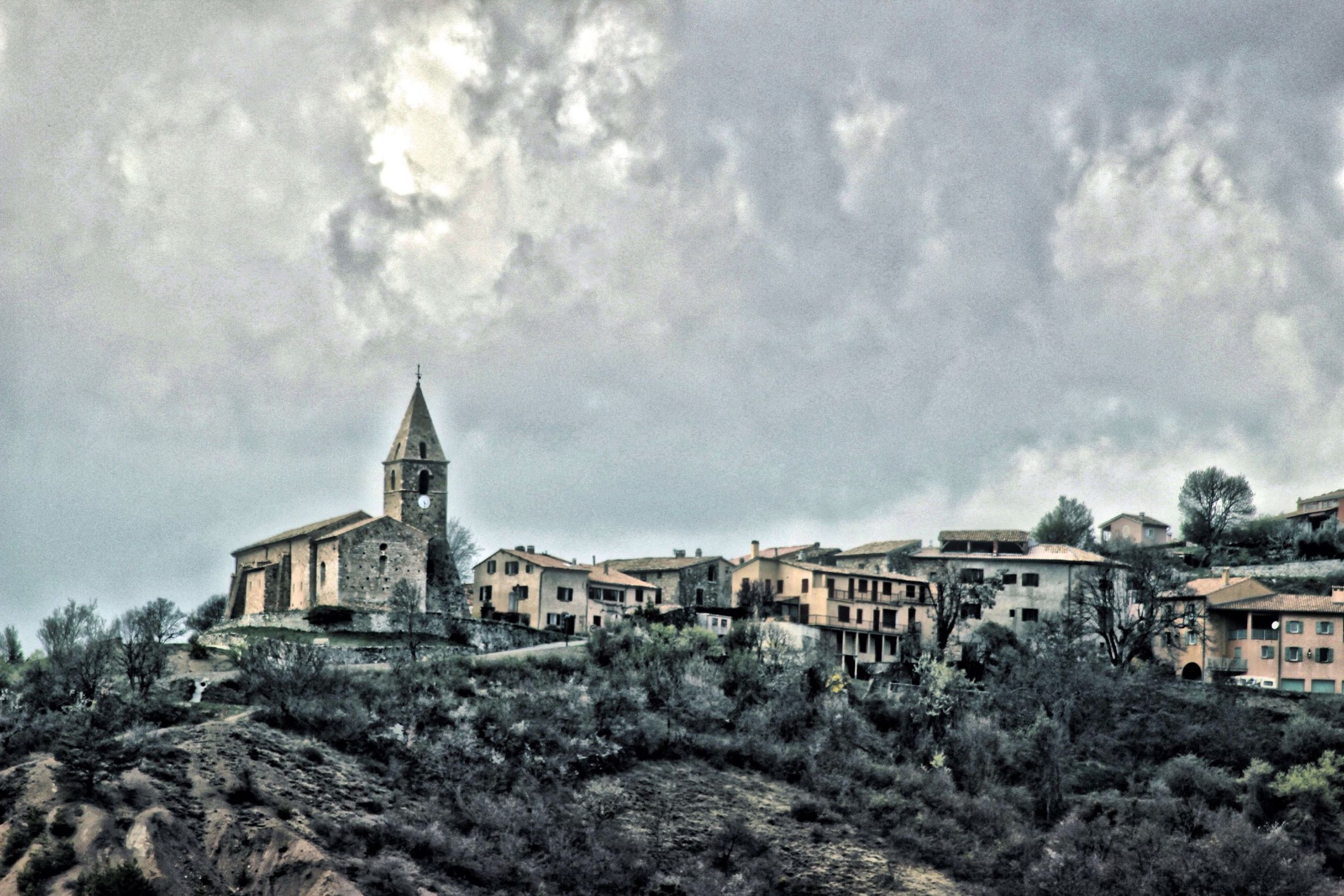 architecture, building exterior, built structure, sky, cloud - sky, tree, house, residential structure, cloudy, residential building, cloud, town, day, outdoors, no people, history, church, residential district, mountain, hill