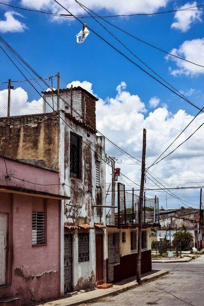Cable Sky Architecture Power Line  Building Exterior Built Structure Cloud - Sky Day Outdoors Electricity Pylon Telephone Line No People City Cuba Santa Clara Cuba The Street Photographer - 2017 EyeEm Awards