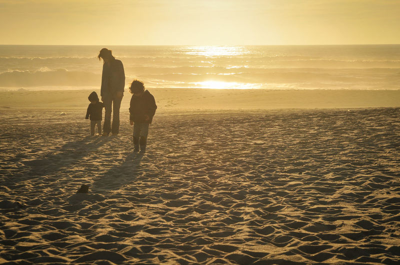 Sunset Two People Sea People Sunlight Togetherness Beach Adult Outdoors Nature Silhouette Sand Men Vacations Adventure Friendship Scenics Bonding Beauty In Nature Full Length