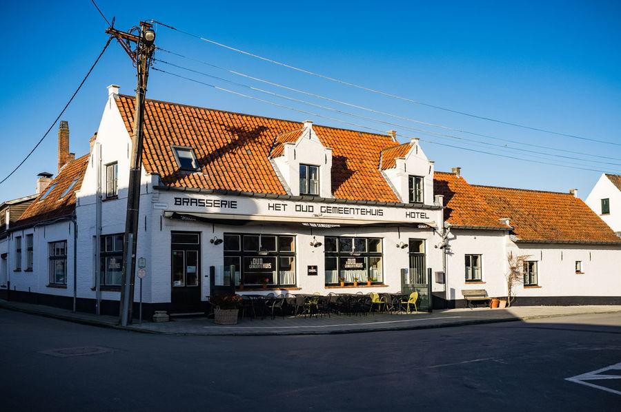 Little village Oostkerke, near Zeebrugge, Bruges and Damme. Bar Belgian Street Belgium Bruincafé Cafe Flanders Toerisme West-Vlaanderen Tourism West Vlaanderen West-Vlaams White Houses Wintersun
