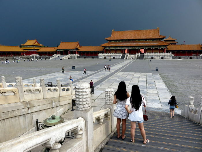 People At Forbidden City Against Overcast Sky