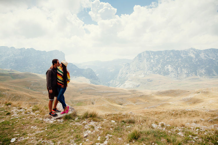 couple travel mountains in summer with beautiful view. Man and woman relax on mountain peak. Couple Nature Tranquility Traveling Adventure Beauty In Nature Casual Clothing Countryside Couple - Relationship Day Durmitor Eye Leisure Leisure Activity Montenegro Mountain Outdoors People Picturesque Sky Summer Togetherness Travel Destinations Two People Young Adult
