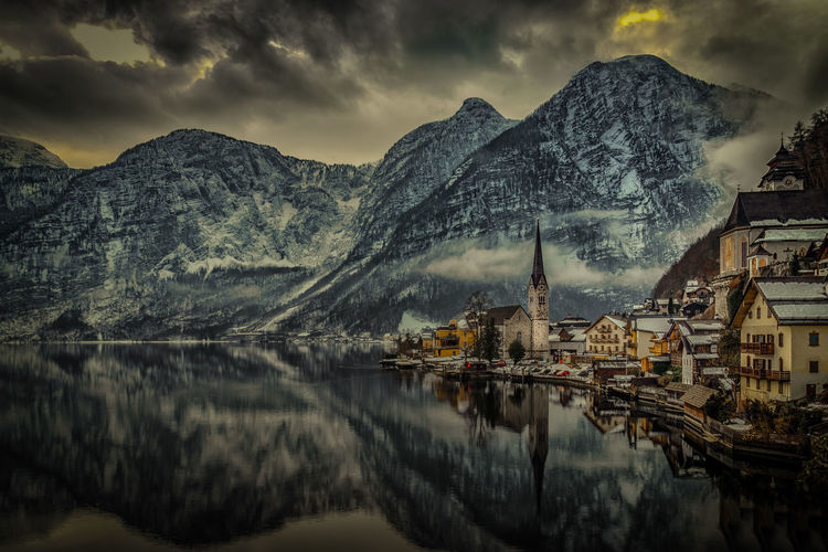 Architecture Beauty In Nature Bridge - Man Made Structure Building Exterior Built Structure Cloud - Sky Connection Day Hallstatt Hallstatt, Austria Mountain Mountain Range Nature No People Outdoors Reflection Reservoir River Scenics Sky Travel Destinations Water