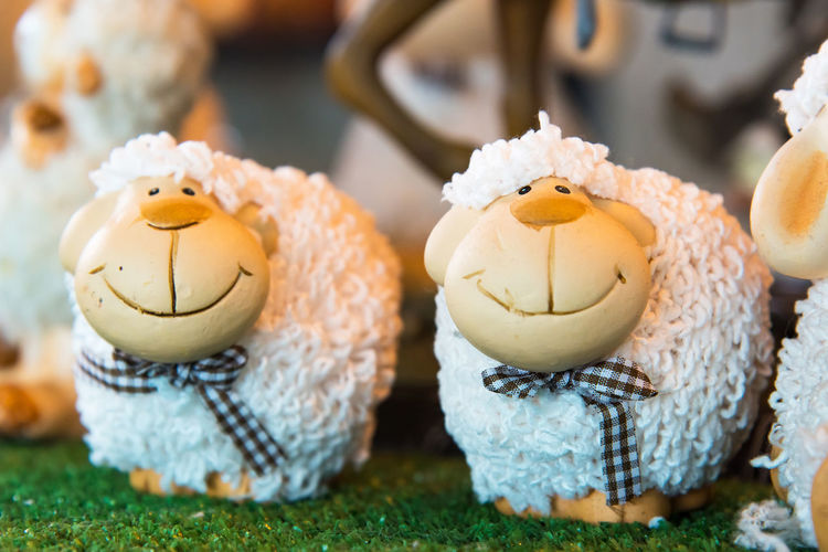 Doll sheep decorated on the table.Thailand Animal Animal Representation Animal Themes Baked Celebration Close-up Cupcake Easter Focus On Foreground Food Food And Drink Freshness Holiday Indulgence Mammal No People Plant Representation Snack Sweet Sweet Food Temptation