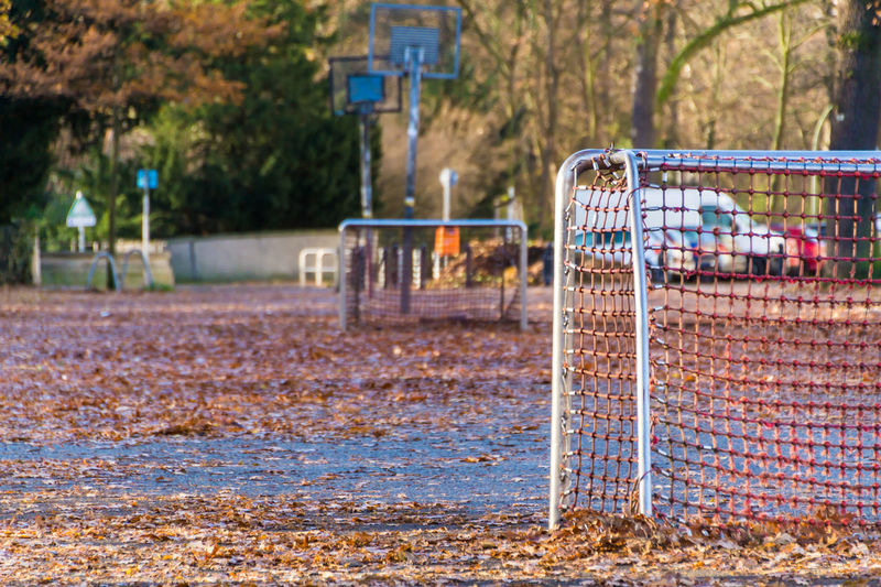 Empty soccer field in park during autumn