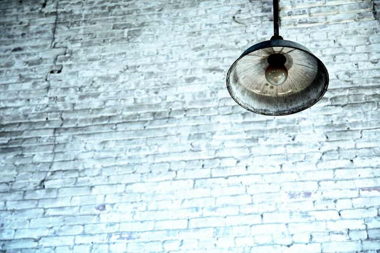 Lights Out. Backgrounds Barn Light Brick Wall Day Deterioration Full Frame Geometry Glass - Material Hanging Light No People Old Old-fashioned Pattern Pen Safety Simplicity Stone Stone Wall Textured  Transparent Wall Wall - Building Feature White Bridge White Wall Window