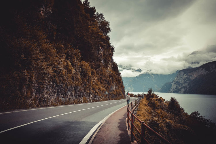 Long Road Cloud - Sky Day Long Mountain Nature No People Outdoors Plant Road Road Marking Sign Sky Transportation Tree
