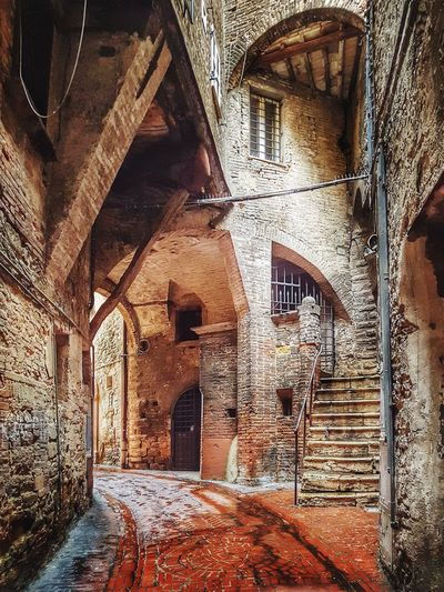 Perugia EyeEm Best Shots Architecture_collection Alley Narrow Narrow Street Old-fashioned Old Buildings Old Town Historical Place Cobblestone Streets Brick Building Italy Italia Italy❤️ Travel Destinations Medieval Architecture MedievalTown Perugia Marche Architecture Built Structure Building Exterior Weathered Historic Old History The Past