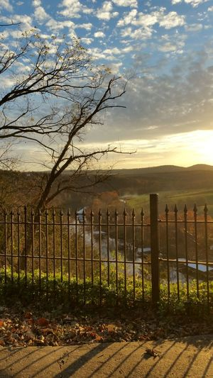Fence Sky Tree Sunset Nature Outdoors No People Picket Fence Water Tranquility Beauty In Nature Cloud - Sky Landscape Day Mountain This Week On Eyeem Golden Hour Cloud And Sky Autumn Sky Ozark Sunset Smartphonephotography Ozarks Work Hard U College Of The Ozarks Branson, Missouri