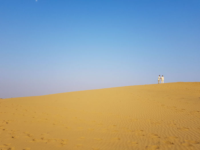 Two people Miniaturized in the Desert Land Sand Sky Clear Sky Desert Scenics - Nature Copy Space Tranquility Tranquil Scene Nature Landscape Sand Dune Horizon Climate Blue Beauty In Nature Arid Climate Day Beach Environment Outdoors No People My Best Photo