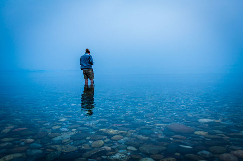 Ankle Deep In Water Lifestyles One Person Outdoors Reflection Sea Shallow Standing Water