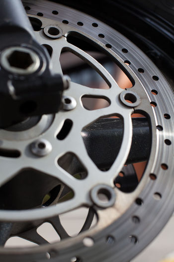 motorcycle disc brakes Aluminum Brakes Chrome Close-up Detail Disc Drive Fast Gear Industry Machine Part Metal Motorbike Motorcycle Motorsports Part Power Round Silver  Steel Technology Tyre Vehicle Vertical Wheel