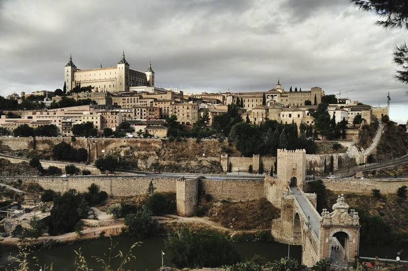 Low Angle View Of Buildings At Toledo Against Cloudy Sky