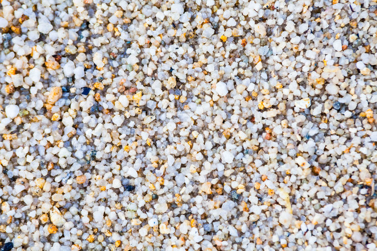 Close up view of hard sand texture for blur background Full Frame Backgrounds No People Textured  Close-up Nature Day Outdoors Abundance Large Group Of Objects Food And Drink Freshness Food High Angle View Still Life Plant Beauty In Nature Flower Wellbeing White Color Pebble Textured Effect Flowerbed