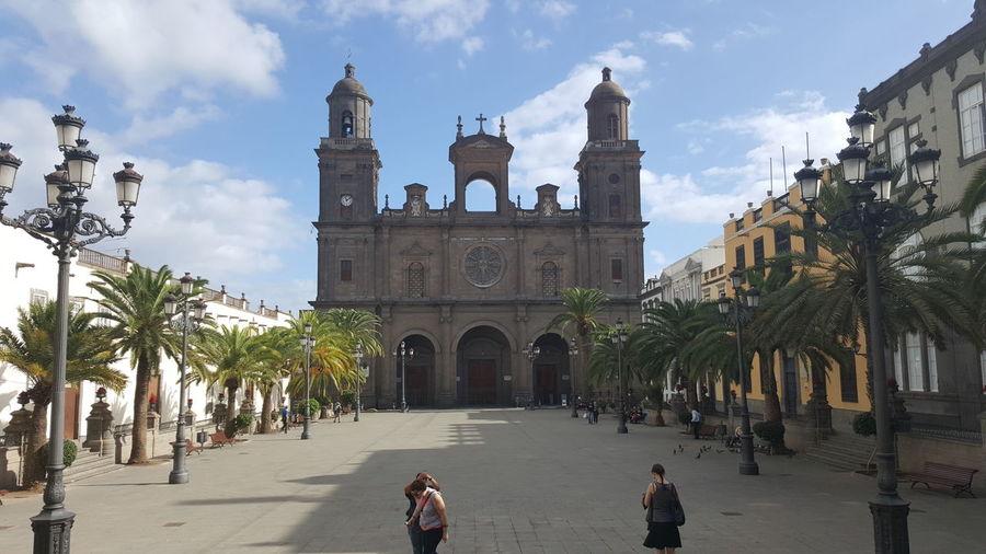 People at las palmas cathedral against sky