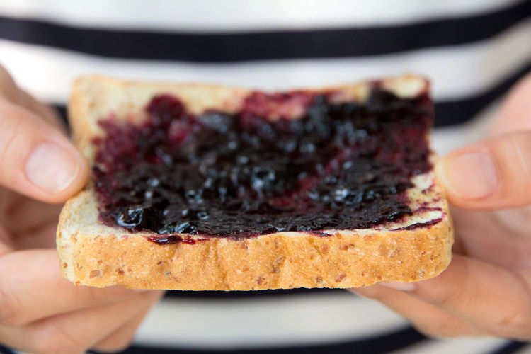 grape jelly sandwich Sandwich Adult Close-up Day Dessert Focus On Foreground Food Food And Drink Freshness Grape Grape Jelly Holding Human Body Part Human Finger Human Hand Indoors  Indulgence Leisure Activity Lifestyles One Person People Personal Perspective Ready-to-eat Real People Sweet Food Unrecognizable Person Women