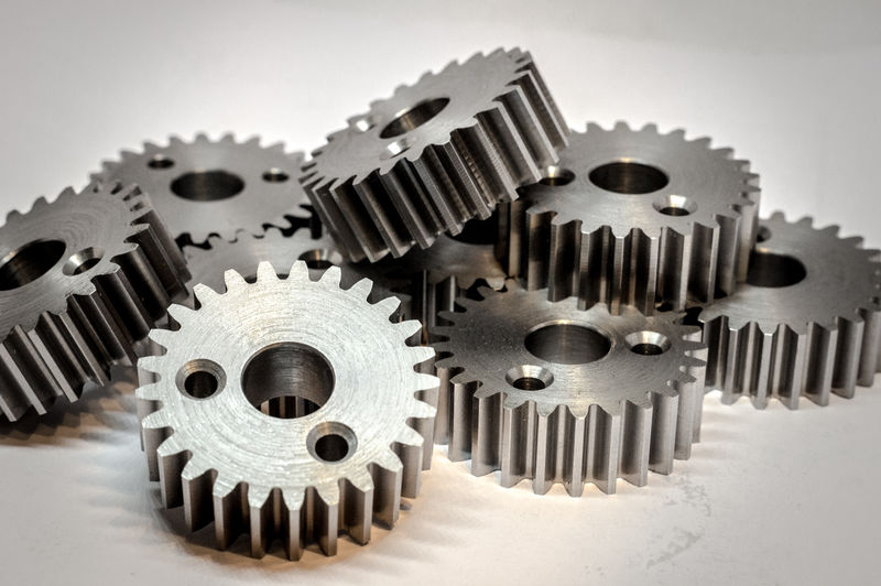 Low angle view of gears against white background