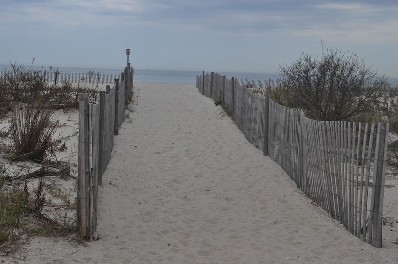 Walking Path to the Ocean at the New Jersey Shore New Jersey Beach Beauty In Nature Horizon Over Water Nature No People Outdoors Sand Scenics Sea Shore Sky Tranquil Scene Tranquility Water Wood Fence