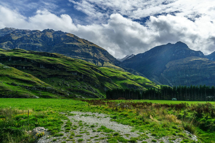 Beauty In Nature Cloud - Sky Day Environment Field Grass Green Color Growth Land Landscape Mountain Mountain Peak Mountain Range Nature No People Non-urban Scene Outdoors Plant Scenics - Nature Sky Tranquil Scene Tranquility