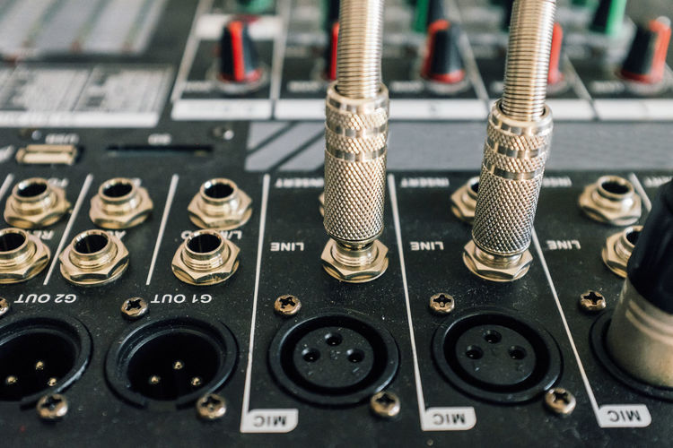 Close-Up Of Jacks Connected To Sound Mixer In Recording Studio