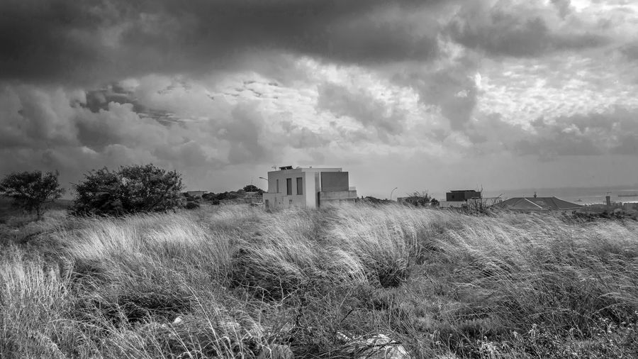 Cloud - Sky Sky Plant Grass Architecture Land Built Structure Nature Field Environment Building Exterior Landscape Day No People Outdoors Building Beauty In Nature Scenics - Nature Rural Scene Blackandwhite Black And White EyeEm Best Shots EyeEm EyeEm Selects
