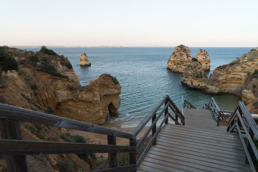 Algarve Coast View Architecture Beauty In Nature Built Structure Clear Sky Horizon Horizon Over Water Nature No People Outdoors Railing Rock Rock - Object Scenics - Nature Sea Sky Staircase Steps And Staircases Tranquil Scene Tranquility Water