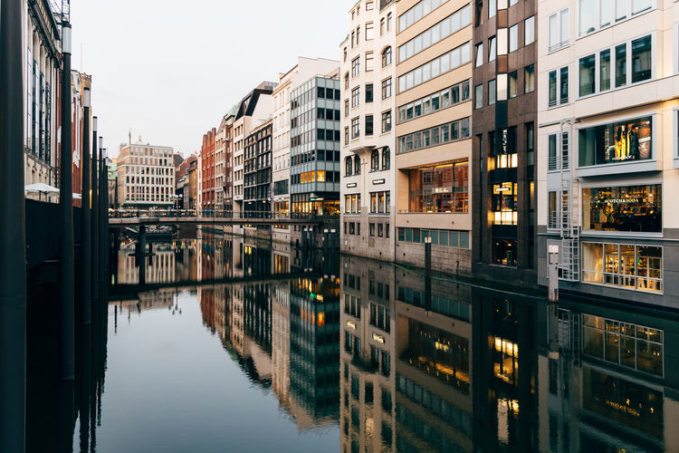 Reflection of buildings on canal in city