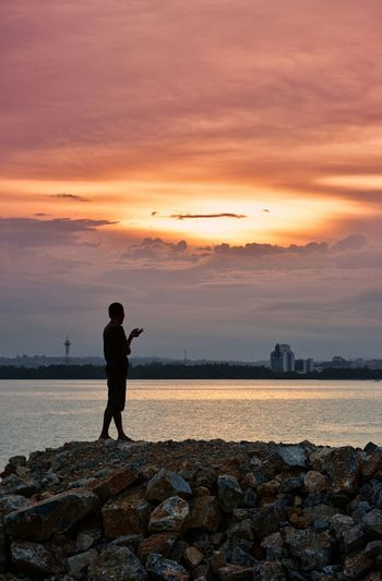 EyeEm Best Shots - Sunsets + Sunrise Sunset Silhouettes Sky_collection Sky And Clouds Sunset_collection Sea And Sky EyeEm Best Shots EyeEm Gallery People Just Around The Corner Kendari Bay