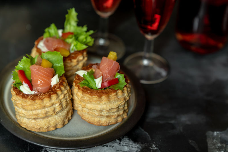 French cuisine, patties with salmon and red wine Elegant Romantic Red Wine French Food Essen Salmon - Seafood Gesundheit Seasonal Wineglass Alcohol Wine Bread Close-up Food And Drink Starter Wine Bottle Fillet