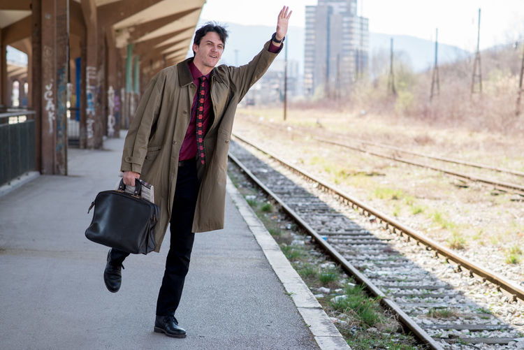 late for train Adult Adults Only Business Businessman City Day Full Length Human Body Part Mature Adult One Man Only One Mature Man Only One Person Only Men Outdoors People Railroad Station Railroad Station Platform Railroad Track Suit Travel Well-dressed Long Goodbye