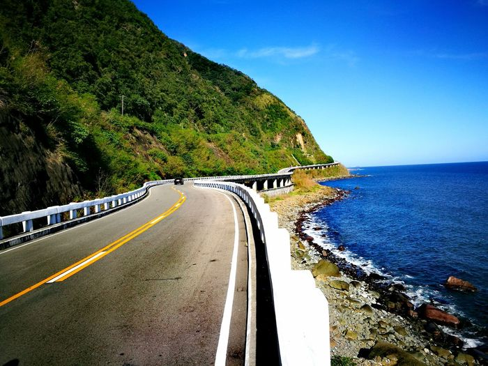 Beauty In Nature Nature Scenics Transportation The Way Forward Sunlight Sky Road Idyllic Tranquil Scene Green Color Non-urban Scene Tree Tranquility Landscape Outdoors No People Day Ilocosnorte P9 Huawei P9leica P9photography Water Beach Huwawei