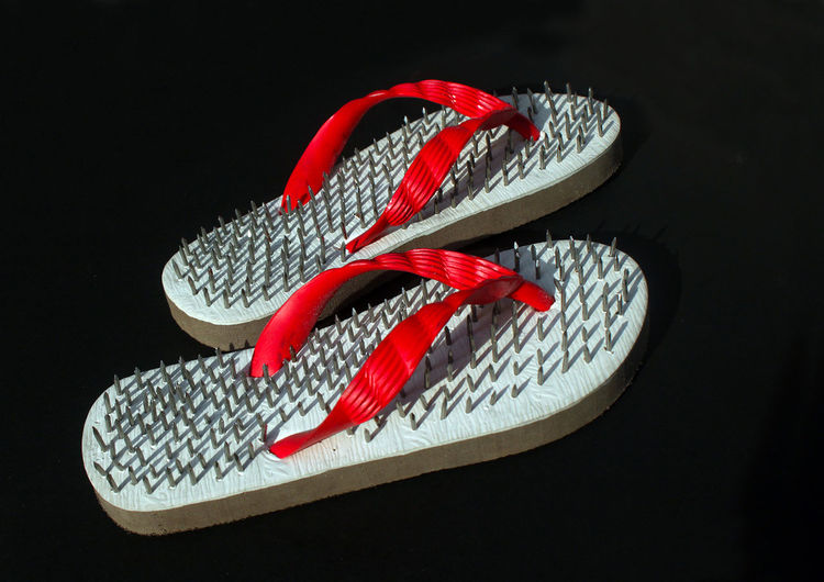 High angle view of red shoes against black background