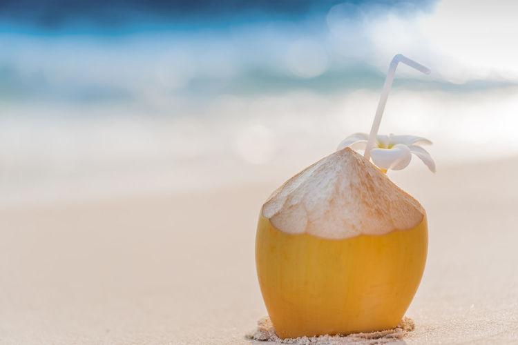 Close-up of orange fruit on beach