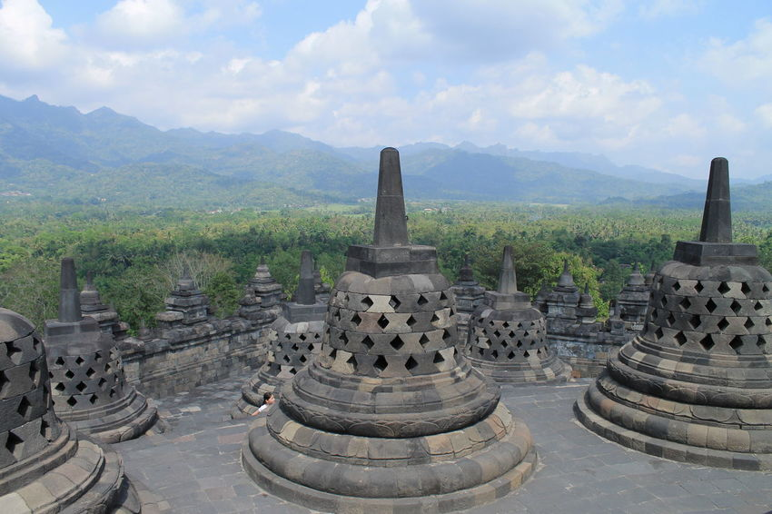 Borobudur Temple, Indonesia INDONESIA Ancient Ancient Civilization Architecture Beauty In Nature Borobudur Building Exterior Built Structure Cloud - Sky Day History Mountain Mountain Range Nature No People Outdoors Place Of Worship Scenics Sky Spirituality Tranquility Travel Destinations Tree