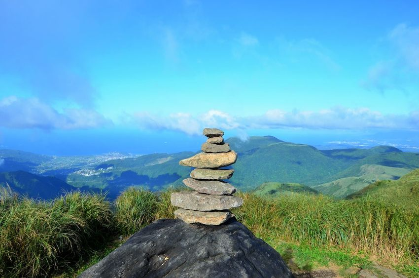 Beauty In Nature Blue Cloud - Sky Day Landscape Lotus Position Mountain Mountain Peak Mountain Range Nature No People Outdoors Religion Scenics Sky Statue Tourism Tranquil Scene Tranquility Tree Wisdom Zen-like