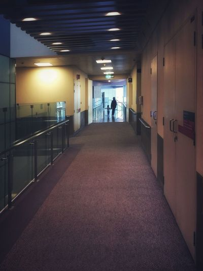Walking hand in hand Perspective Architecture Illuminated Indoors  Ceiling Built Structure Real People Lighting Equipment Arcade Corridor Building The Way Forward Direction Flooring Walking People Full Length Women