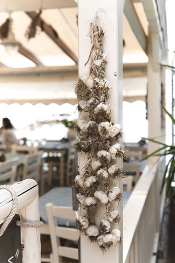 Garlic Architecture Art And Craft Building Building Exterior Built Structure Close-up Craft Creativity Day Decoration Focus On Foreground Garlic Bulb Hanging Nature No People Outdoors Railing Sculpture Wood - Material