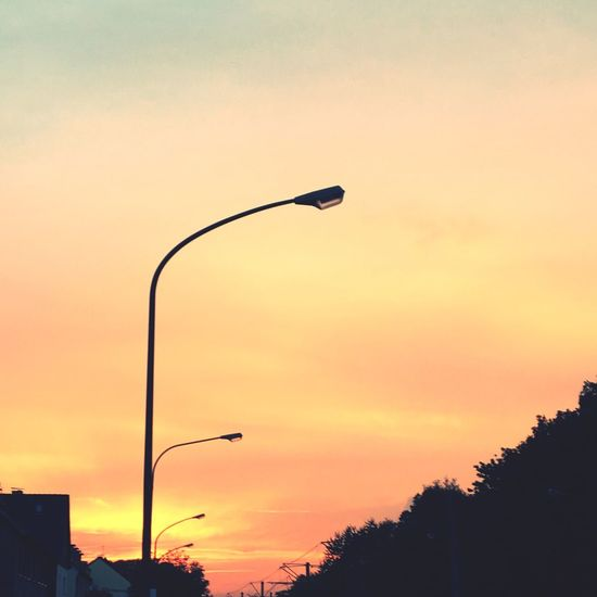 Sunset Street Light Sky Illuminated Cloud Beauty In Nature Outdoors Lamp Post Nature Vibrant Color Summer Sun Clear Sky Multi Colored This Is Germany Nature Nature_collection