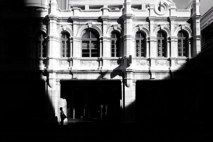 Silhouette people in historic building