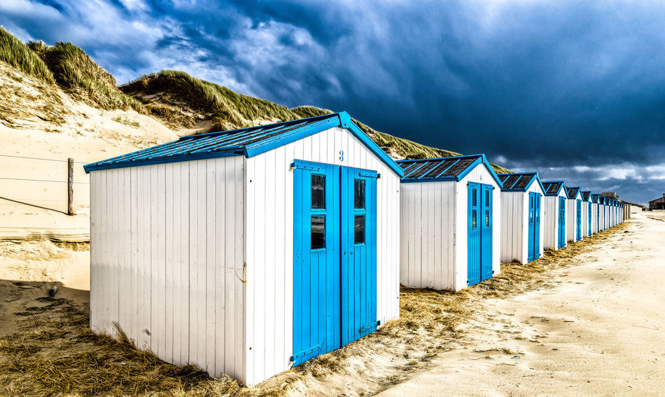 Architecture Beach Hut Beauty In Nature Blue Built Structure Closed Cloud Cloud - Sky Cloudy Day House Mountain Nature No People Outdoors Scenics Sky The Way Forward Tranquil Scene Tranquility Weather Strandhuisjes Texelstrand texel