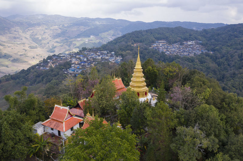 Panoramic view of temple and buildings against mountains
