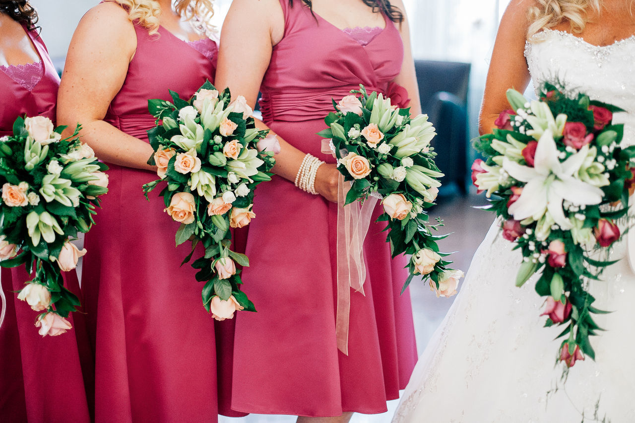 Bride And Bridesmaids Holding Flower Bouquets